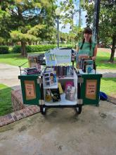 Mikayla, Winter Park Library's Community Outreach Librarian, brings the book bike to local events
